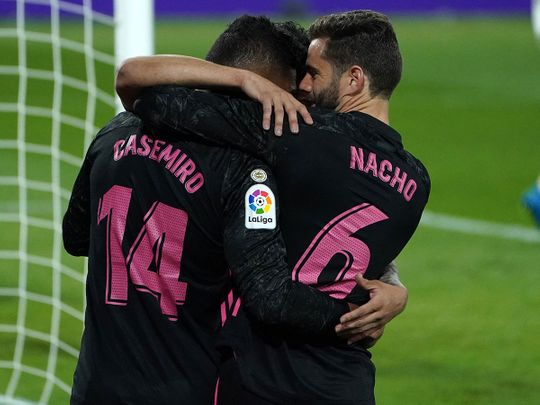 Real Madrid midfielder Casemiro celebrates with Nacho Fernandez after scoring against Real Valladolid