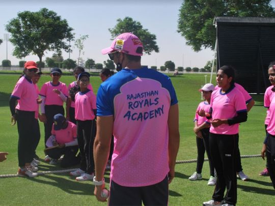 Coach George Cremer with students at the Rajasthan Royals Academy UAE at Dubai Sevens