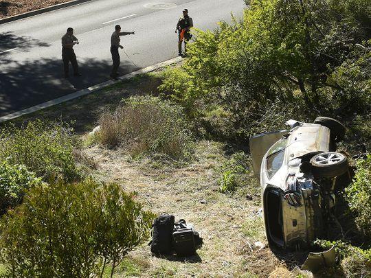 LA County officers survey the Tiger Woods car crash scene