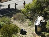 LA County officers survey the Tiger Woods car crash scene