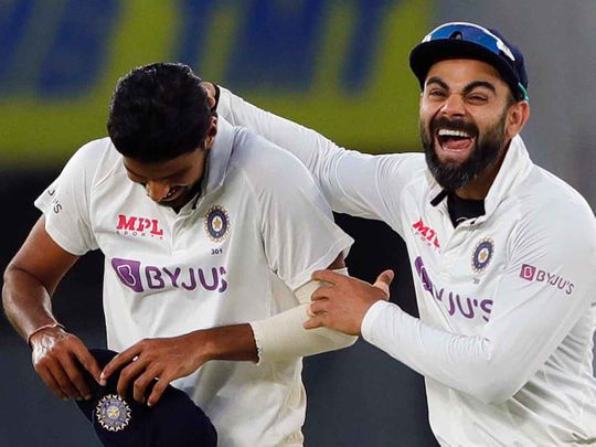 India's Washington Sundar and Virat Kohli celebrate the dismissal of England's James Anderson during the 2nd day of the 3rd Test Match in the series between India and England at Narendra Modi Stadium, Motera in Ahmedabad on Thursday.