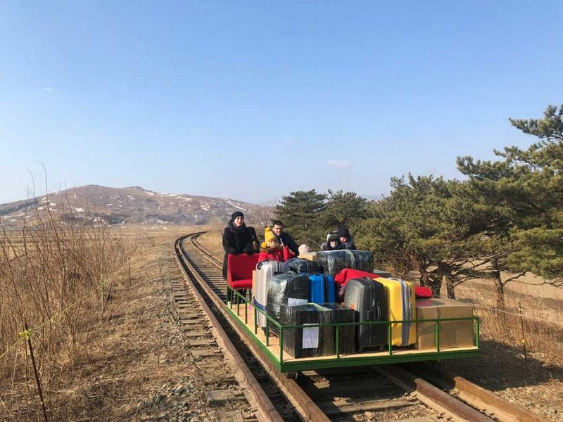 Russian diplomats arrive from North Korea on rail trolley due to COVID-19 curbs