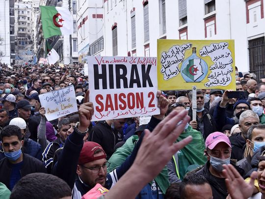 Algerian anti-government protesters take part in a demonstration in the capital Algiers, on February 26, 2021.