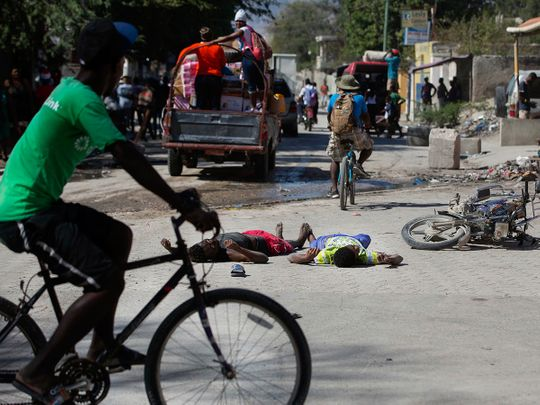 The bodies of two inmates lie on the street outside the Croix-des-Bouquets Civil Prison after an attempted breakout, in Port-au-Prince, Haiti.