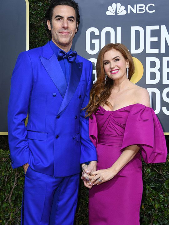 In this file photo actor Sacha Baron Cohen and his wife actress Isla Fisher at  annual Golden Globe Awards on January 5, 2020, at The Beverly Hilton hotel in Beverly Hills, California. Sacha Baron Cohen is nominated for both Borat Subsequent Moviefilm and The Trial of the Chicago 7.