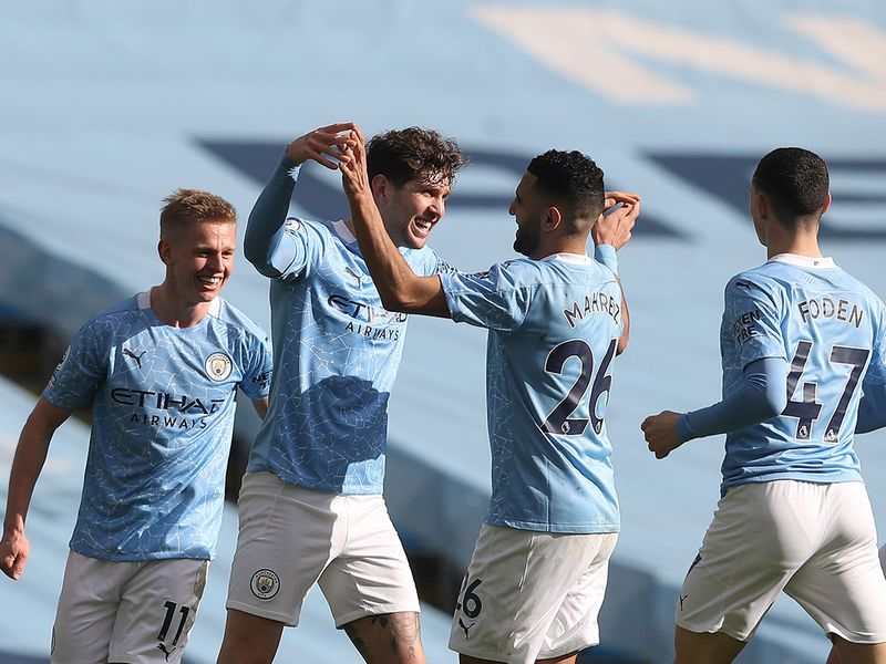 Manchester City's John Stones celebrates with teammates after scoring the winner against West Ham