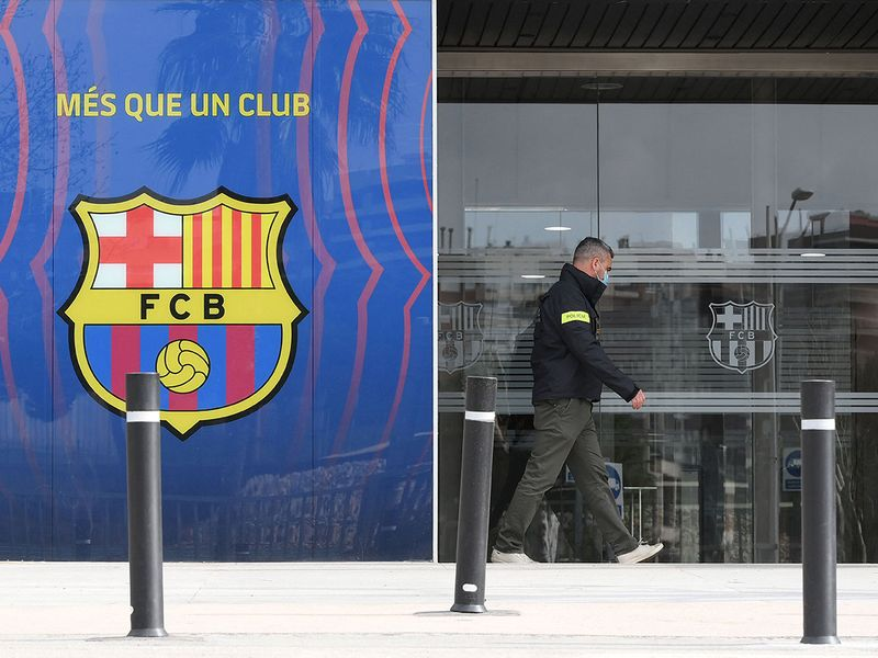 A policeman leaves the Barca FC office building after the latest raid.