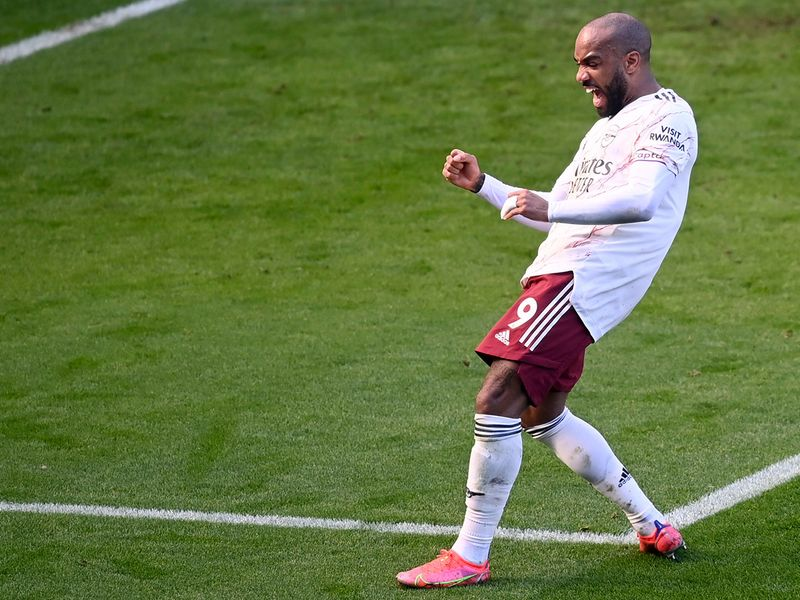 Alexandre Lacazette celebrates goal against Leicester.