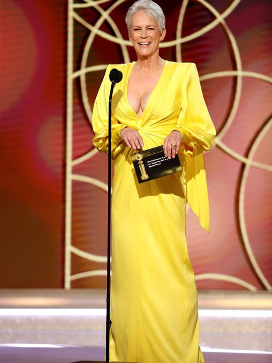 American actress Jamie Lee Curtis wore a yellow Alex Perry long-sleeved, floor-length dress which featured a plunging neckline.