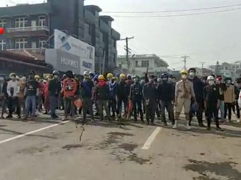 Demonstrators block a street during a protest against the military coup, in Lashio, Shan State, Myanmar, March 1, 2021.