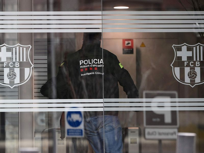 Police raid the Barca FC offices.