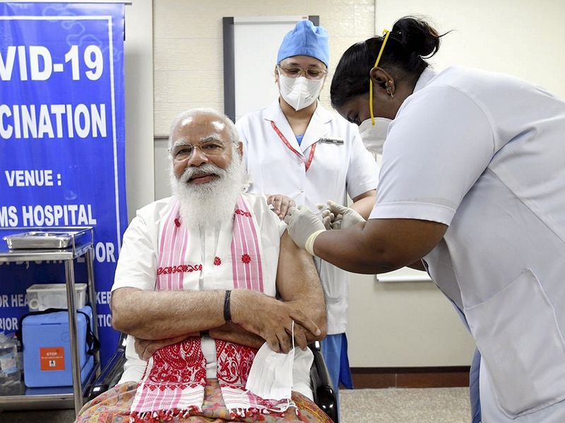 Prime Minister Narendra Modi is administered a COVID-19 vaccine at AIIMS, in New Delhi, on Monday, March 1, 2021.