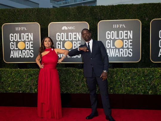 This handout photo courtesy of the HFPA shows Salma Hayek and Sterling K. Brown elbow bump at the Golden Globes