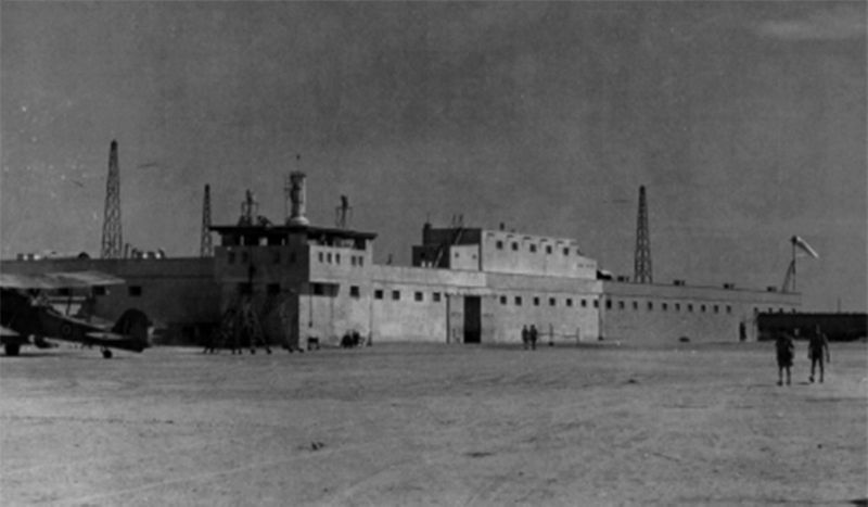 The rest house with its 1939 extension, including a snall door in extreme right.  The five rooms added in 1935 are seen above the main entrance.  (photo: US Army Air Forces, C. 1945, detail).