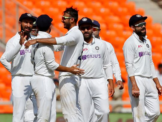 Axar Patel celebrates a wicket against England with India teammates