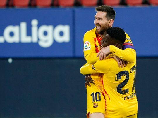 Barcelona's Messi and Moriba celebrate goal.