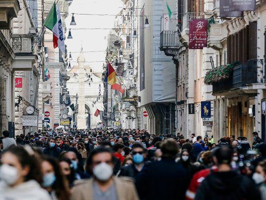 People crowd Via del Corso