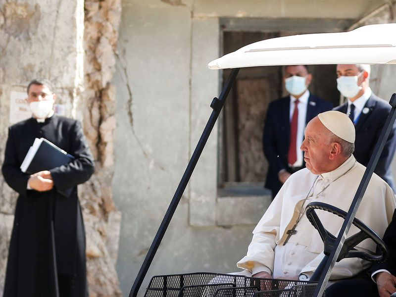 Pope Francis holds a minute of silence at the destroyed cathedral in Mosul's old city, Iraq.