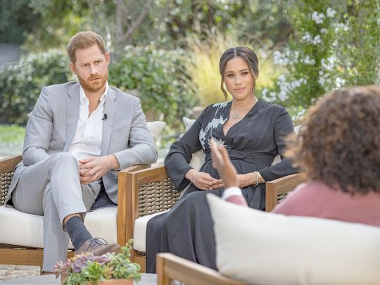Prince Harry, left, and Meghan