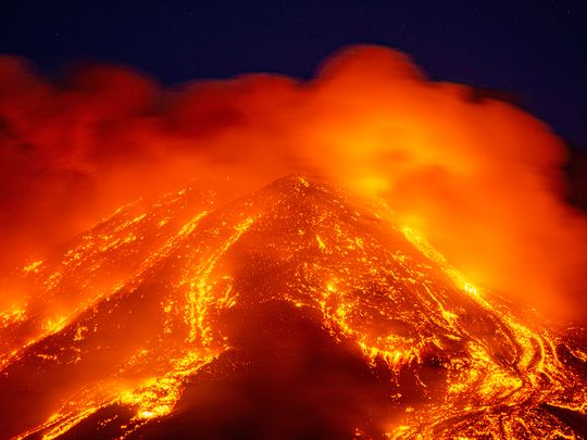 Lava gushes from the Mt. Etna volcano near Catania, southern Italy.