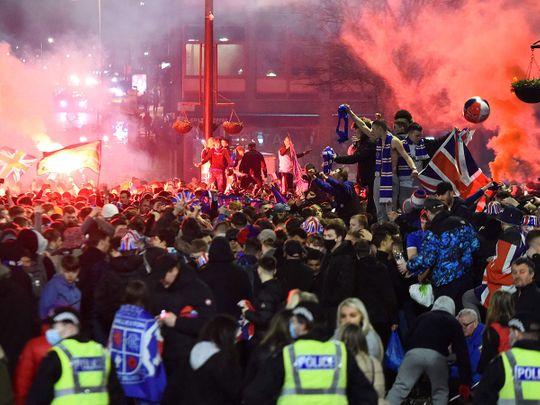 Rangers fans break COVID lockdown rules to celebrate in George Square, Glasgow