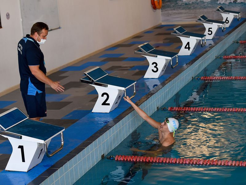 Students train at the Swimming Centre of Excellence at GEMS Wellington Academy — Al Khail