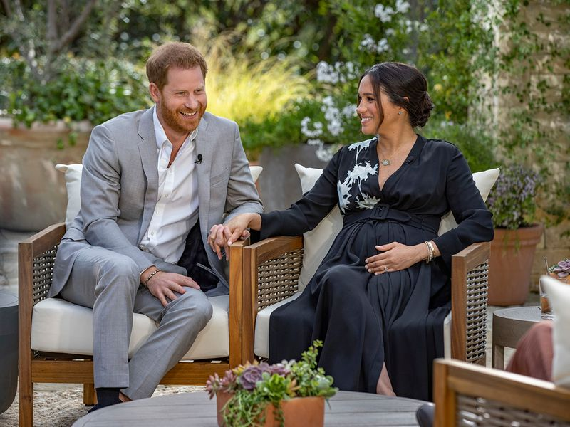 This image provided by Harpo Productions shows Prince Harry, left, and Meghan, Duchess of Sussex, speaking about expecting their second child during an interview with Oprah Winfrey.