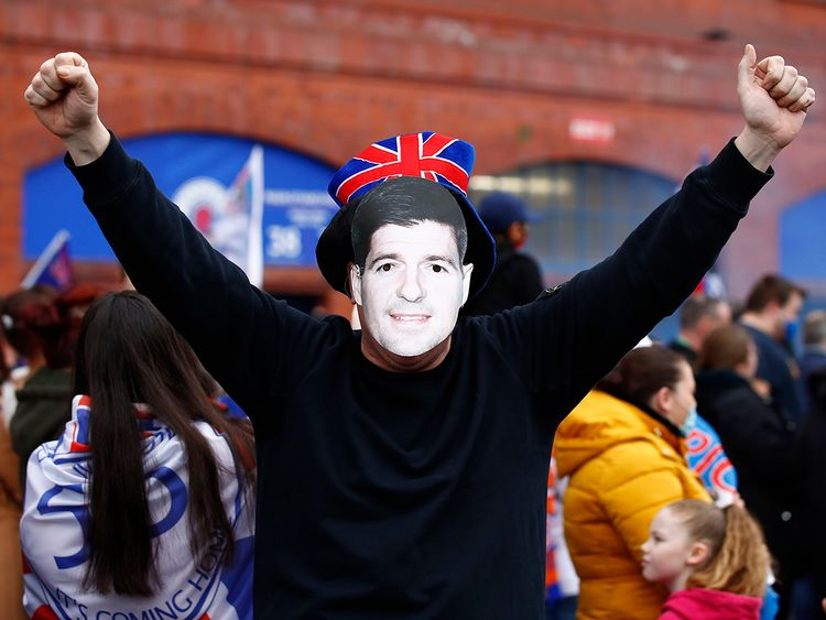 Among other ways of celebrating, Rangers fans held up cardboard cut-outs of manager Steven Gerrard and even wore masks of his face. Gerrard joined the club in 2018; this marks his first league win, too.