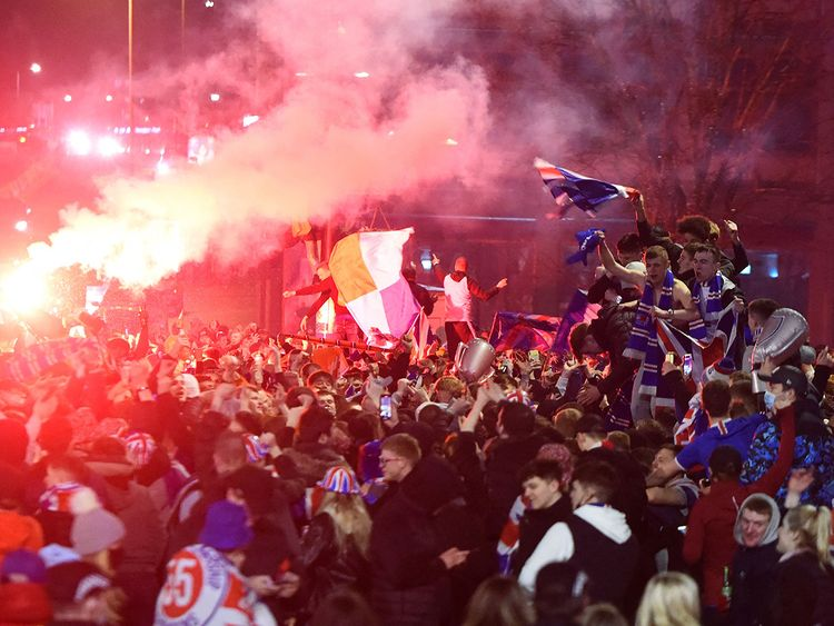 Fans celebrate in George Square in central Glasgow after Rangers were confirmed to be 20 points clear of second-place Celtic.