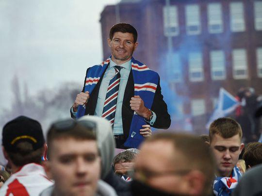 Fans hold aloft a live-size cut-out of Steven Gerrard after Rangers won the Scottish Premiership title