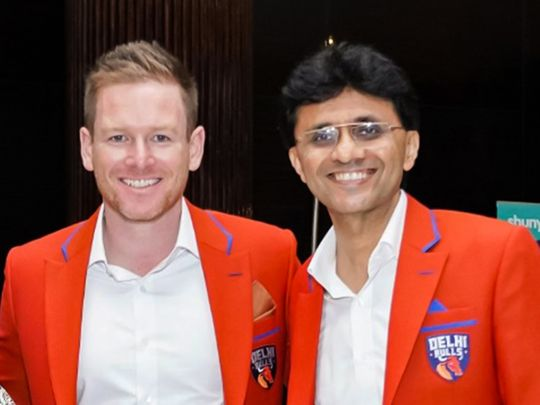 Anis Sajan (right) with Eoin Morgan