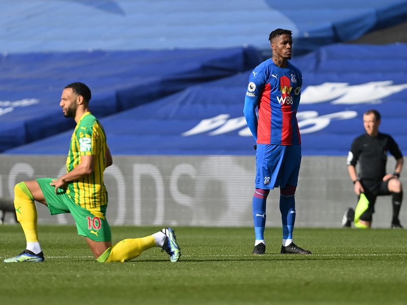 Wilfried Zaha refuses to take a knee, demanding more action against racism.