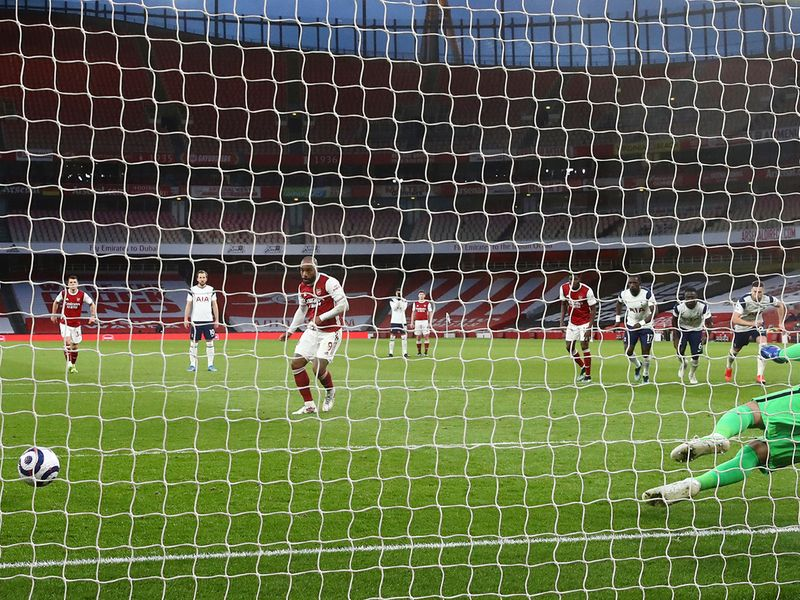 Alexandre Lacazette scores penalty against Tottenham Hotspur.