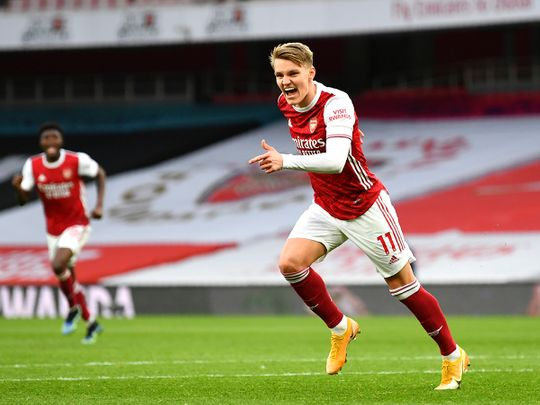 Martin Odegaard celebrates goal for Arsenal against Spurs.
