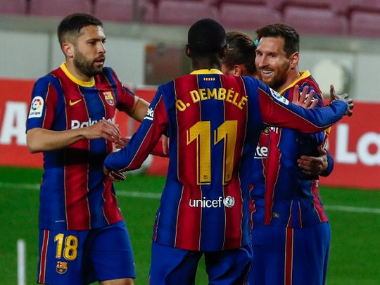 Lionel Messi scored twice against Huesca