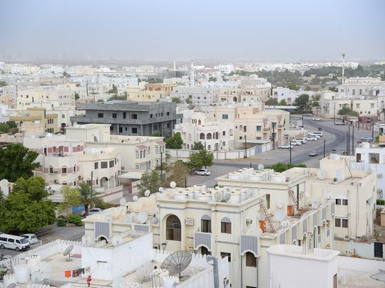 Stock Oman Muscat skyline people
