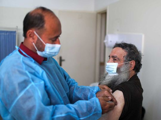 Palestine health worker covid vaccine