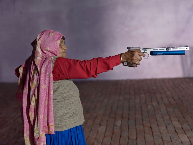 Chandro Tomar, 89, practices with her air pistol at a range being built at her house in the village of Johri, India, Feb. 14, 2021. Tomar, believed to be the oldest professional sharpshooter in the world, is a feminist icon in India who has mentored and coached dozens of young women in her village and beyond for more than 20 years. There's even a Bollywood movie based on her life and that of fellow competitor and sister-in-law Prakashi Tomar.