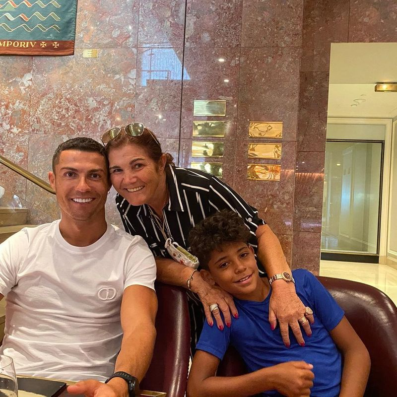 Cristiano Ronaldo with his mother and son.
