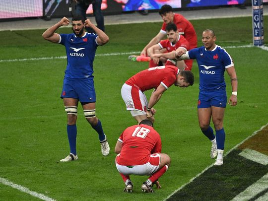 France lock Swan Rebbadj (L) and centre Gael Fickou (R) celebrate after scoring the winning try during the Six Nations clash against Wales