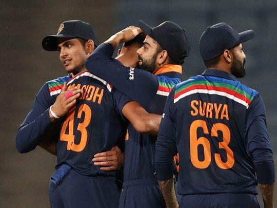 India's Prasidh Krishna celebrates with skipper Virat Kohli after taking the wicket of England's Tom Curran