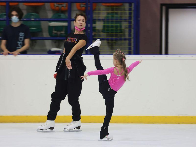Young ice-skater Lyudmila Zykova with coach Svetlana Volkova
