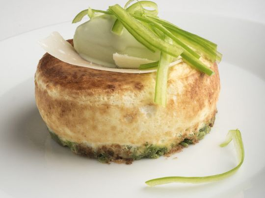 A fusion souffle - Parmesan souffle with green financer and green pepper ice cream