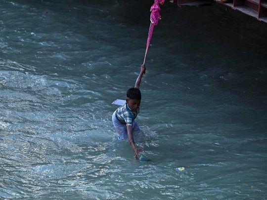 Boy Ganga coins Ganges Hindu river