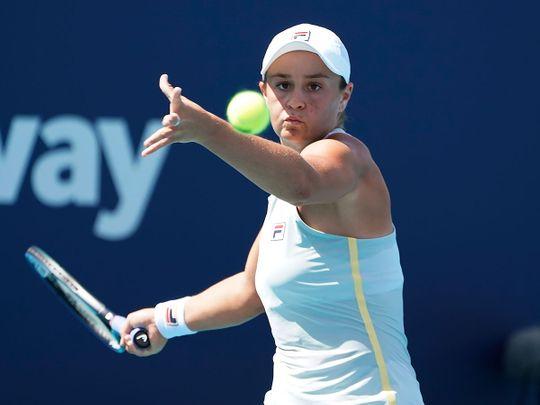 Ashleigh Barty of Australia returns to Jelena Ostapenko of Latvia, during the Miami Open