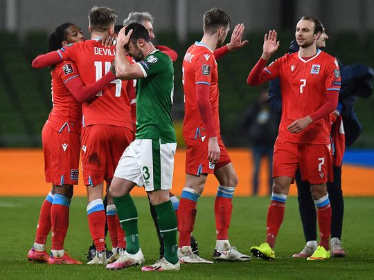Luxembourg's striker Gerson Rodrigues (L) celebrates with teammates at the final whistle during the World Cup qualifier against Ireland