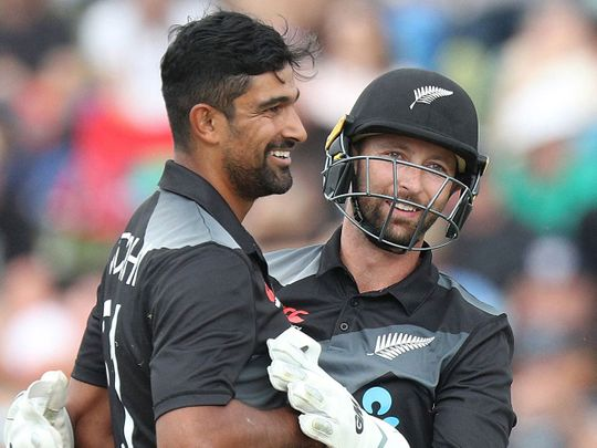 New Zealand's Ish Sodhi (L) is congratulated by wicketkeeper Devon Conway against Bangladesh