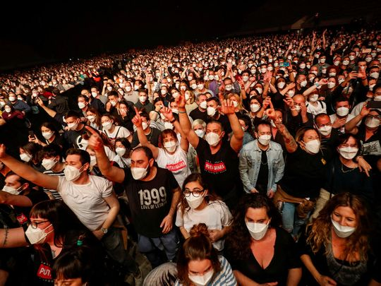 People wearing protective masks attend a concert of at the Palau Sant Jordi, the first massive concert since the beginning of the coronavirus disease (COVID-19) pandemic in Barcelona, Spain, March 27, 2021.