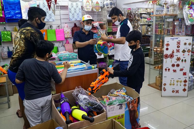 Indian buying colour and water guns at Madhoor store in Bur Dubai as they prepare to celebrate Holi, Indian festival of colours.