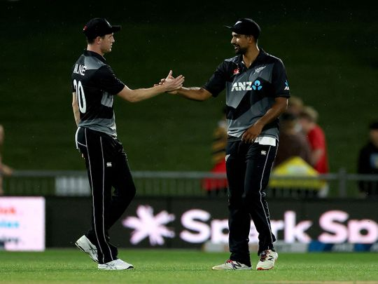 New Zealand's Ish Sodhi celebrates the team's victory over Bangladesh with teammate Adam Milne